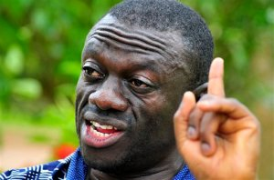 """FILE - In this Wednesday, April 20, 2011 file photo, opposition leader Kiiza Besigye speaks during a rally in Kampala, Uganda. An opposition leader in Uganda who is running for president is under house arrest to prevent him from holding rallies that have been called illegal by the government, a police spokeswoman said. Kiiza Besigye of the Forum for Democratic Change party is being detained in his own home near the capital, Kampala, as a preventive measure """"to ensure that there is no breach of peace,"""" said police spokeswoman Polly Namaye on Thursday, Oct. 15, 2015. (AP Photo/Ronald Kabuubi,File)"""