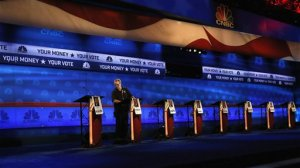 A crew member checks the candidate podiums at the venue for the Oct. 28 CNBC Republican presidential debate, Tuesday, Oct. 27, 2015, inside the Coors Events Center at the University of Colorado in Boulder, Colo. Republican presidential candidates taking the debate stage Wednesday in Colorado are hoping to carry momentum from a 2014 U.S. Senate victory in this toss-up state where independent voters outnumber the electorate from both major parties. (AP Photo/Brennan Linsley)