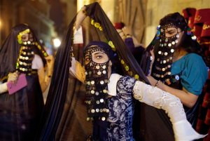 "In this Wednesday, Sept. 23, 2015 picture, Egyptian girls wear ceremonial ancient clothes and ""Yashmak"", a veil concealing all of the face except the eyes, as they celebrate Eid al-Adha at El-Moez Street in historical Fatimid Cairo, Egypt. (AP Photo/Amr Nabil)"