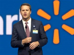 FILE - In this June 5, 2015 file photo, Wal-Mart Store, Inc., Chief Executive Officer Doug McMillon speaks at the Wal-Mart shareholder meeting in Fayetteville, Ark. Wal-Mart on Wednesday, Oct. 14, 2015 said it expects profit to fall for its next fiscal year and cut its sales outlook for this year as it works to fend off intensifying competition and perk up stores with better customer service. (AP Photo/Danny Johnston, File)