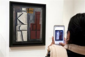 """""""Untitled,"""" one of the works of artist Joaquin Torres-Garcia, is displayed during a preview of a retrospective of his work, at the Museum of Modern Art, in New York, Tuesday, Oct. 20, 2015. (AP Photo/Richard Drew)"""