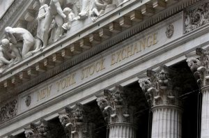 FILE - This Oct. 2, 2014, file photo, shows the facade of the New York Stock Exchange. Global stock markets were lower Tuesday, Oct. 27, 2015, as investors awaited monetary policy announcements from central banks and the outcome of China's economic planning meeting. (AP Photo/Richard Drew, File)
