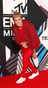 Justin Bieber arrives for the 2015 MTV European Music Awards in Milan, Italy, Sunday, Oct. 25, 2015. (AP Photo/Antonio Calanni)