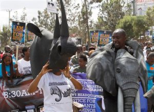 Kenyans wearing animal masks join demonstrators as they walk through the streets of Nairobi, Saturday, Oct. 3, 2015, participating in a Global March to support wildlife Elephants and Rhinos. Kenya is a leading wildlife safari destination that has been grappling with declining wildlife numbers, some thousands of people walked 10 kilometers in the capital Nairobi.   (AP Photo/Khalil Senosi)