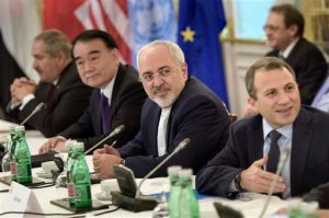 Chinese Vice Minister of Foreign Affairs Li Baodong, second left, and Iranian Foreign Minister Mohammad Javad Zarif, second right, wait with others for the start of talks on Syria at a hotel in Vienna, Austria, Friday, Oct. 30, 2015. US Secretary of State John Kerry is acknowledging that progress will be difficult as he launches a marathon day of talks aimed at ending the Syrian War but is expressing some hope of headway. With 19 foreign ministers and other senior dignitaries attending, participants say the fact that the talks are happening despite deep divisions among key players are in themselves a sign of success. (Brendan Smialowski/Pool Photo via AP)