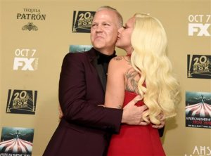 "Lady Gaga, right, kisses executive producer/director/writer Ryan Murphy as they arrive at the Los Angeles premiere screening of ""American Horror Story: Hotel"" at Regal Cinemas L.A. (Photo by Chris Pizzello/Invision/AP)"