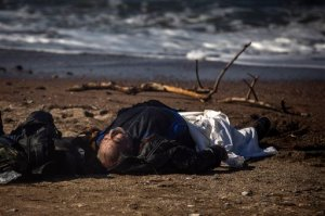 The body of a dead man lays on a beach in Petra village on the northeastern Greek island of Lesbos, Friday, Oct. 30, 2015. The deaths occurred amid a surge of crossings to Greek islands involving migrants and refugees from Syria, Afghanistan and other countries ahead of winter and as European governments weight taking tougher measures to try and limit the number of arrivals in Europe. (AP Photo/Santi Palacios)