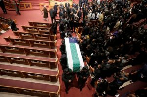 New York City Police Department officer Randolph Holder's coffin is carried from his funeral service, Wednesday, Oct. 28, 2015, at the Greater Allen A.M.E. Cathedral in the Queens borough of New York. Holder was shot and killed Tuesday, Oct. 20 while pursuing a suspect in the Harlem neighborhood of New York. (AP Photo/Mary Altaffer, Pool)
