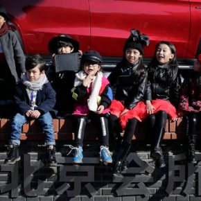 China's easing of birth limit a boon to couples,companies