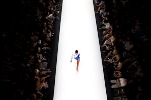In this Tuesday, Oct. 20, 2015 photo, a model walks the runway in the Ori Minkovsky show during Fashion Week in Tel Aviv, Israel. The show came at a time of escalating regional tensions that began with clashes at a Jerusalem holy site last month and quickly spread across Israel, the West Bank and Gaza. (AP Photo/Oded Balilty)