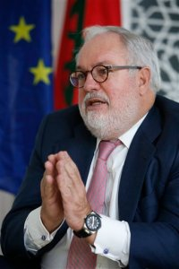 European Union Climate Commissioner Miguel Arias Canete gestures during an interview with the Associated Press at the Sofitel Hotel in Rabat, Morocco, Monday, Oct. 12, 2015. Europe's climate chief has acknowledged for the first time that climate pledges made by national governments ahead of a major U.N. conference fall short of meeting the goal of keeping global warming below 2 degrees Celsius (3.6 degrees Fahrenheit). (AP Photo/Abdeljalil Bounhar)