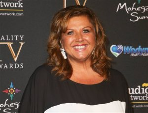 FILE - In this May 13, 2015 file photo, Abby Lee Miller arrives at the 3rd Annual Reality TV Awards in Los Angeles. Miller has been charged with hiding $775,000 worth of income from the Lifetime network reality show and spin-off projects during her Chapter 11 bankruptcy. Federal prosecutors in Pittsburgh announced the bankruptcy fraud indictment Tuesday, Oct. 13, against 50-year-old Abigale Lee Miller, formerly of Penn Hills. (Photo by Rich Fury/Invision/AP, File)