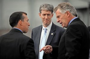 BrightFarms CEO Paul Lightfoot, left, meets Virginia Agriculture and Forestry Secretary Todd Haymore, center, and Gov. Terry McAuliffe at the greenhouse farm in the Elkwood  area of Culpeper county, Va. on Tuesday, Oct. 13, 2015. BrightFarms is investing $7.35 million to build two new greenhouses. Governor McAuliffe approved a $75,000 grant from the Fund to assist with the project, which Culpeper County is matching with $75,000 in local grant funds. (Peter Cihelka/The Free Lance-Star via AP) MANDATORY CREDIT