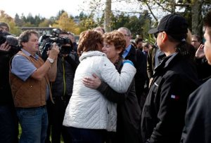 Premier of British Columbia Christy Clark hugs Tofino Mayor Josie Osborne following a news conference in Tofino, British Columbia,Tuesday, Oct. 27, 2015. Investigators are trying to unravel the mystery of what caused a whale watching boat to capsize off Vancouver Island on Sunday, killing multiple people. (Chad Hipolito/The Canadian Press via AP) MANDATORY CREDIT