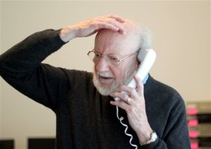 Scientist William C. Campbell talks on the phone at his home in North Andover, Mass., Monday, Oct. 5, 2015. Campbell is one of three scientists from the U.S., Japan and China who won the Nobel Prize in medicine on Monday for discovering drugs to fight malaria and other tropical diseases that affect hundreds of millions of people every year. (AP Photo/Mary Schwalm)