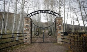 The Glenwood Cemetery gate is shown Thursday, Oct. 29, 2015, in Park City, Utah. Lawyers for the family of 4-year-old Utah boy crushed by a tombstone at the cemetery say he died after shoddy maintenance left the historic headstone weak and dangerous. The Glenwood Cemetery Association contends that the cemetery was well-maintained and the 1889 headstone was solid before the boy started playing on it on July 5, 2012. (AP Photo/Rick Bowmer)