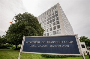 In this photo taken June 19, 2015, the Transportation Department's Federal Aviation Administration (FAA) building in Washington. The FAA proposed a record $1.9 million fine Tuesday against an aerial photography company for flying drones in crowded New York and Chicago airspace without permission. (AP Photo/Andrew Harnik)