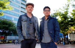"In this Oct. 3, 2015 photo, co-directors South Korean Choi Wooyoung, right, and Belgian Steven Dhoedt pose for a photo in Seoul, South Korea. ""Reach for the SKY,"" a documentary film directed by them about the social and personal costs of South Koreans' craze for being admitted to the nation's top three universities, depicts a system that is a far cry from U.S. President Barack Obama's praise of the Asian country as a model for U.S. educational reforms. The documentary, a co-production of Belgium and South Korea, premiered during the 20th Busan International Film Festival, which ends Saturday, Oct. 10, 2015. (AP Photo/Lee Jin-man)"