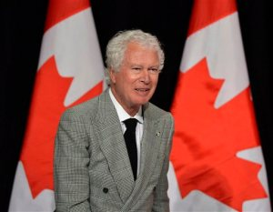FILE - In this Jan. 24, 2013 file photo, Ken Taylor, former Canadian ambassador to Iran, speaks to the Empire Club of Canada in Toronto. Taylor, who kept Americans hidden at his residence during the 1979 Iran hostage crisis, has died. He was 81. Taylor's wife, Pat, said Ken died Thursday, Oct. 15, 2015 after a two month battle with colon cancer. (Nathan Denette/The Canadian Press via AP) MANDATORY CREDIT