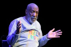 FILE - In this Friday, Nov. 21, 2014 file photo, comedian Bill Cosby performs at the Maxwell C. King Center for the Performing Arts, in Melbourne, Fla. Los Angeles prosecutors said Thursday, Oct. 1, 2015, that police had presented the results of their investigation into model Chloe Goins' accusations that Cosby drugged and accosted her in a bedroom of the Playboy Mansion in August 2008. There is no timetable for when prosecutors will determine whether to file a case against the comedian. (AP Photo/Phelan M. Ebenhack, File)