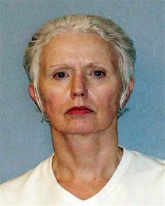 FILE - This undated file photo provided in 2011 by the U.S. Marshals Service shows Catherine Greig, the longtime girlfriend of Whitey Bulger, sentenced in 2012 to an eight-year prison term for conspiracy to harbor a fugitive, identity fraud and conspiracy to commit identity fraud. Greig is scheduled to be in federal court Monday, Oct. 19, 2015, in Boston to face a contempt charge for refusing to tell whether other people helped Bulger during his 16 years on the run. (U.S. Marshals Service via AP, File)