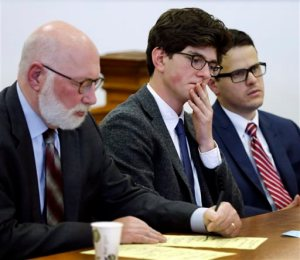 Owen Labrie, center, listens to a recorded statement from his victim with his lawyer J.W. Carney, left, and Sam Zaganjoir before being sentenced in Merrimack County Superior Court Thursday, Oct. 29, 2015, in Concord, N.H. The graduate of the exclusive St. Paul's School was sentenced to a year in jail for sexually assaulting a 15-year-old freshman girl as part of a tradition in which upperclassmen competed to rack up sexual conquests. Labrie was allowed to remain free on bail while he appeals his conviction. (AP Photo/Jim Cole, Pool)