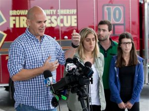 Passengers of Dynamic Airways Boeing 767, from left; Andres Gallegos, Camilia Diaz, David Magro and his sister Daniela Magro, all from Venezuela, talk to the media, Thursday, Oct. 29, 2015, at Fort Lauderdale/Hollywood International Airport in Dania Beach, Fla. The passenger plane's engine caught fire Thursday as it prepared for takeoff, and passengers had to quickly evacuate on the runway using emergency slides, officials said. he plane was headed to Caracas, Venezuela. (AP Photo/Wilfredo Lee)