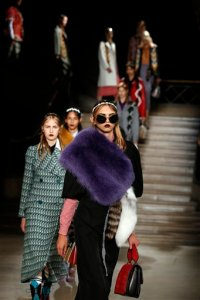 Models wear creations for Miu Miu's Spring-Summer 2016 ready-to-wear fashion collection presented during the Paris Fashion Week, Wednesday, Oct. 7, 2015 in Paris, France. (AP Photo/Francois Mori)