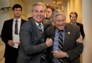 House Majority Leader Kevin McCarthy of Calif., left, and Rep. Fred Upton, R-Mich., laugh together as they walk from a meeting on Capitol Hill in Washington, Monday, Oct. 26, 2015. Speaker John Boehner is pressing ahead with one last deal as he heads for the exits, pushing to finalize a far-reaching, two-year budget agreement with President Barack Obama before handing Congress' top job over to Rep. Paul Ryan this week, congressional officials said Monday.(AP Photo/Carolyn Kaster)