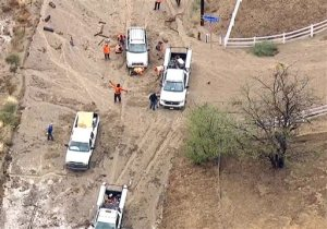 This still frame from video provided by KABC-TV shows vehicles stuck in a muddy road in the mountainous community of Lake Hughes, Calif., about 65 miles north of downtown Los Angeles, Thursday, Oct. 15, 2015. Flash flooding in northern Los Angeles County has filled several roads with mud, stranding vehicles and blocking traffic on one of the state's main highways. (KABC-TV via AP) MANDATORY CREDIT; TV OUT