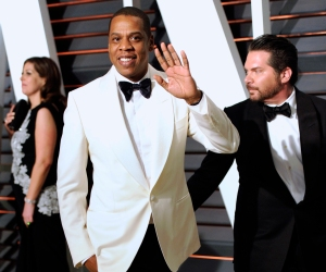 """FILE - In this Feb. 23, 2015 file photo, Jay Z arrives at the 2015 Vanity Fair Oscar Party in Beverly Hills, Calif. The rapper appeared in a Los Angeles federal court on Tuesday, Oct. 13, 2015, for the start of a copyright infringement trial in which he and music producer Timbaland are accused of violating the rights of famed Egyptian composer Baligh Hamdi to create their 1999 hit """"Big Pimpin'."""" (Photo by Evan Agostini/Invision/AP, File)"""