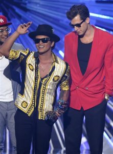 "FILE - In this Aug. 30, 2015, file photo, Bruno Mars, left, and Mark Ronson accept the award for male video of the year for ""Uptown Funk"" at the MTV Video Music Awards in Los Angeles. The Weeknd and Mark Ronson and Bruno Mars are tied for five nominations each at the Soul Train Awards this year on Nov. 6. The show will air on Centric and BET on Nov. 29. (Photo by Matt Sayles/Invision/AP, FIle)"