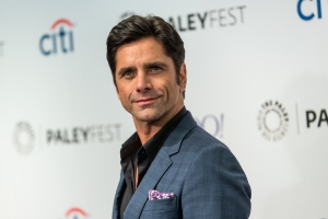 FILE - In this Sept. 15, 2015 file photo, John Stamos attends the at 2015 PaleyFest Fall TV Previews at The Paley Center for Media  in Beverly Hills, Calif. Los Angeles prosecutors charged Stamos on Wednesday, Oct. 14, 2015, with one count of driving under the influence of a drug stemming from his arrest in June in Beverly Hills. (Photo by Paul A. Hebert/Invision/AP, File)