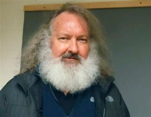 FILE - In this Oct. 9, 2015 file photo provided by the Vermont State Police, actor Randy Quaid stands in the Vermont State Police barracks in St. Albans, Vt. In a hearing Monday, Oct. 12, 2015 in St. Albans, Quaid was ordered held on $500,000 bail on charges that he skipped out of the country five years ago after being charged with vandalism in California. Quaid and his wife Evi Quaid were detained at the Canadian border Friday night while trying to re-enter the United States after Canadian officials granted Evi Quaid citizenship but denied Randy Quaid permanent residence and said he would be deported. Evi Quaid was in court Monday in Burlington, where  she also was ordered held on $500,000 bail.  (Vermont State Police via AP, File)