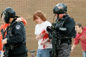 """FILE - In this file photo taken Jan. 5, 2009, during a mock shooter exercise at Bowling Green State University in Bowling Green, Ohio, participants portraying victims are led to a triage unit. A 2015 review by The Associated Press finds that eight years after the Virginia Tech massacre led to tighter security at U.S. colleges, some schools make """"active shooter"""" training mandatory for incoming students, and Ohio takes a hands-off approach by leaving policies up to schools to develop. (J.D. Pooley/Sentinel-Tribune via AP, File) MANDATORY CREDIT; TOLEDO BLADE OUT"""