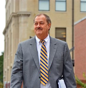 FILE - In a Thursday, Oct. 1, 2015 file photo, Don Blankenship makes his way out of the Robert C. Byrd United States Courthouse on the first day of jury selection in Charleston, W.Va.Defense attorneys rested their case Monday, Nov. 16, 2015, without calling any witnesses in the high-profile trial of ex-Massey Energy CEO Blankenship. Their announcement came shortly after the prosecution rested following weeks of testimony asserting that Blankenship put dollars ahead of human safety in the years before the worst U.S. coal mine disaster in decades.(AP Photo/Tyler Evert, File)
