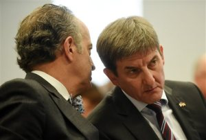 Christian Koch, right, the president and CEO of Volkswagen Group of America Chattanooga Operations, David Geanacopoulos, executive vice president for public affairs and general counsel for Volkswagen Group of America, during a legislative hearing in Chattanooga, Tenn., Thursday, Oct. 29, 2015, about the effects of the diesel emissions cheating scandal at the plant. Koch told the panel that up to 25 percent of the more than 500,000 sedans that have been made at the German automaker's lone U.S. plant were diesels. (Angela Lewis Foster/Chattanooga Times Free Press via AP) THE DAILY CITIZEN OUT; NOOGA.COM OUT; CLEVELAND DAILY BANNER OUT; LOCAL INTERNET OUT; MANDATORY CREDIT