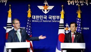 U.S. Defense Secretary Ash Carter, left, answers a reporter's questions during a joint news conference with South Korean Defense Minister Han Min Koo after the 47th Security Consultative Meeting (SCM) at Defense Ministry in Seoul, South Korea, Monday, Nov. 2, 2015. The U.S. and South Korea are pledging to strengthen their combined defenses against what they call threats by North Korea, but they announced no specific new steps toward a long-delayed transfer of wartime control of South Korean forces from the U.S. military to the South Korean government. (AP Photo/Lee Jin-man, Pool)