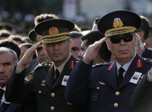 Turkey's Land Forces Commander Gen. Salih Zeki Colak, left, and Air Forces Commander Gen. Abidin Unal attend funeral prayers for Lt. Col. Ihsan Ejdar, 43, a Turkish army officer killed in a Kurdish rebel attack at Turkey-Iraq border on Saturday, at the Kocatepe Mosque in Ankara, Turkey, Sunday, Oct. 18, 2015. Terrorism and the violence has rocked southeastern Turkey since the resumption of fighting between the military and the Kurdistan Workers' Party, or PKK. The separatist group is considered a terror organization by the Turkey, the U.S. and the EU.(AP Photo/Burhan Ozbilici)