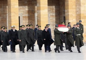 Turkish Prime Minister Ahmet Davutoglu, center-right, and army commanders walk to the mausoleum of Turkey's founder Mustafa Kemal Ataturk before a meeting of High Military Council in Ankara, Turkey, Thursday, Nov. 26, 2015. Turkey has released audio recordings of what it says are the Turkish military's repeated warnings to the pilot of the Russian plane before it was shot down at the border with Syria. Turkey shot down the Russian Su-24 bomber on Tuesday, insisting it had violated its airspace despite repeated warnings.(AP Photo)