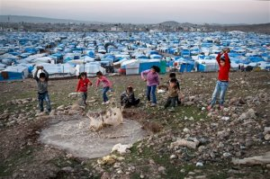 In this Saturday, Nov. 28, 2015 photo, Syrian refugee children play at a temporary refugee camp in Irbil, northern Iraq. Some 240,000 refugees who fled the fighting in Syria now live in Iraq. Their children are neither citizens of Syria, their families' country of origin, or of Iraq, the country where they now live. (AP Photo/Seivan M. Salim)