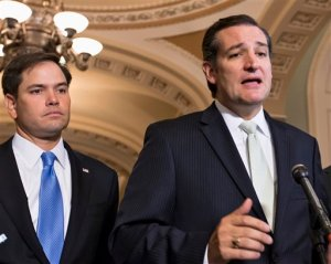 FILE - In this Sept. 27, 2013 file photo, Sen. Ted Cruz, R-Texas, right, accompanied by Sen. Marco Rubio, R-Fla., speaks on Capitol Hill in Washington. Republican presidential rivals Rubio and Cruz are backpedaling furiously as they try to outmaneuver each other on immigration. Rubio co-wrote a massive 2013 immigration bill that passed the Senate. He disavows it now, but Cruz won't stop talking about it.  (AP Photo/J. Scott Applewhite, File)