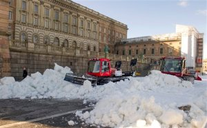 FILE - This is a March 12, 2012 file photo shows snow being moved in preparation prior to the World Cup Cross Countery skiiing sprint competition round the Stockholm Royal Palace. Snowy white winters are likely to become a thing of the past for most Swedes.  The national weather service Monday Nov. 2, 2015 released a new analysis of how climate change will affect the Nordic country _ and it's bad news for skiing enthusiasts. (AP Photo/Bertil Ericson)  SWEDEN OUT