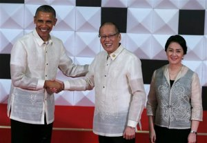 Philippines President Benigno Aquino III and his sister Maria Elena Aquino-Cruz, right, greet U.S. President Barack Obama to the welcome dinner at the Asia-Pacific Economic Cooperation (APEC) summit in Manila, Philippines Wednesday, Nov. 18, 2015.  Leaders from 21 countries and self-governing territories are gathering in Manila for the Asia Pacific Economic Cooperation summit. The meeting's official agenda is focused on trade, business and economic issues but terrorism, South China Sea disputes and climate change are also set to be in focus. (AP Photo/Bullit Marquez)