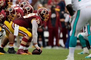 ADVANCE FOR SUNDAY, NOV. 1 AND THEREAFTER - In this photo taken Sept. 13, 2015, the Washington Redskins offensive line is seen during the first half of an NFL football game against the Miami Dolphins in Landover, Md. In their actions and their words at the outset of this season, new general manager and second-year head coach Jay Gruden made quite clear that they wanted the Washington Redskins to be a run-first team. And they did, indeed, begin things that way, becoming the first NFL club in nearly a decade to have a pair of guys each rush for 100 yards in Weeks 1 and 2. (AP Photo/Mark Tenally)