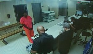 FILE - In this undated file image from video provided by the Waller County Sheriff's Department, Sandra Bland stands in front of a desk at Waller County Jail in Hempstead, Texas. Waller County, which is being sued by the family of Bland who died in the county jail in the summer of 2014, says she committed suicide because she was despondent over her relatives' refusal to quickly bail her out. The assertion is contained in a court motion in mid November 2015 asking that a lawsuit by relatives of Sandra Bland against Waller County be dismissed. (Waller County Sheriff's Department via AP, File)