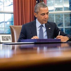 Obama signs 2-year budget, debt deal before defaultdeadline