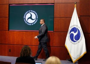 Transportation Secretary Anthony Foxx arrives for a news conference about Takata air bags, Tuesday, Nov. 3, 2015, at the Transportation Department in Washington. U.S. auto safety regulators fined Takata Corp. of Japan $70 million for lapses in the way it handled recalls of millions of explosion-prone air bags that are responsible for eight deaths and more than 100 injuries worldwide. (AP Photo/Alex Brandon)