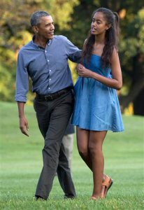 In this photo taken Aug. 23, 2015, President Barack Obama and his daughter Malia walk across the South Lawn of the White House in Washington from Marine One. The 17-year-old is among the millions of U.S. high school seniors who are nervously taking standardized tests, completing college admissions applications, filling out financial aid forms and writing personal essays, all on deadline, before spending the coming months anxiously waiting to find out if they got into their dream school. (AP Photo/Carolyn Kaster)