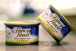 This Monday, Nov. 16, 2015, photo shows Fancy Feast cat food, fish and shrimp feast flavor, a product of Thailand, purchased at a Publix market in Orlando, Fla. A report commissioned by Nestle SA found that impoverished migrant workers in Thailand are sold or lured by false promises and forced to catch and process fish that ends up in the global food giant's supply chains. Nestle is not a major purchaser of seafood in Southeast Asia but does some business in Thailand, primarily for its Purina brand Fancy Feast cat food. (AP Photo/John Raoux)
